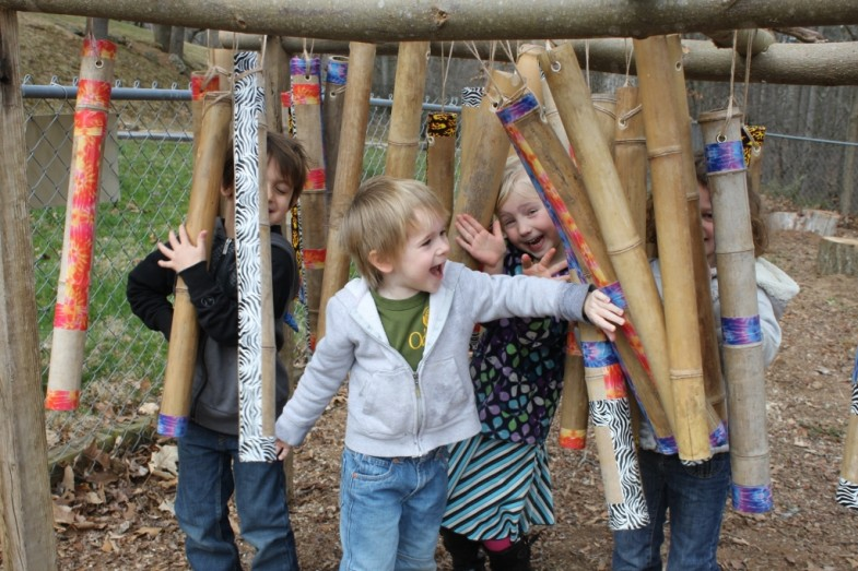 Holistic School PreK Students Playing with Wooden Chimes