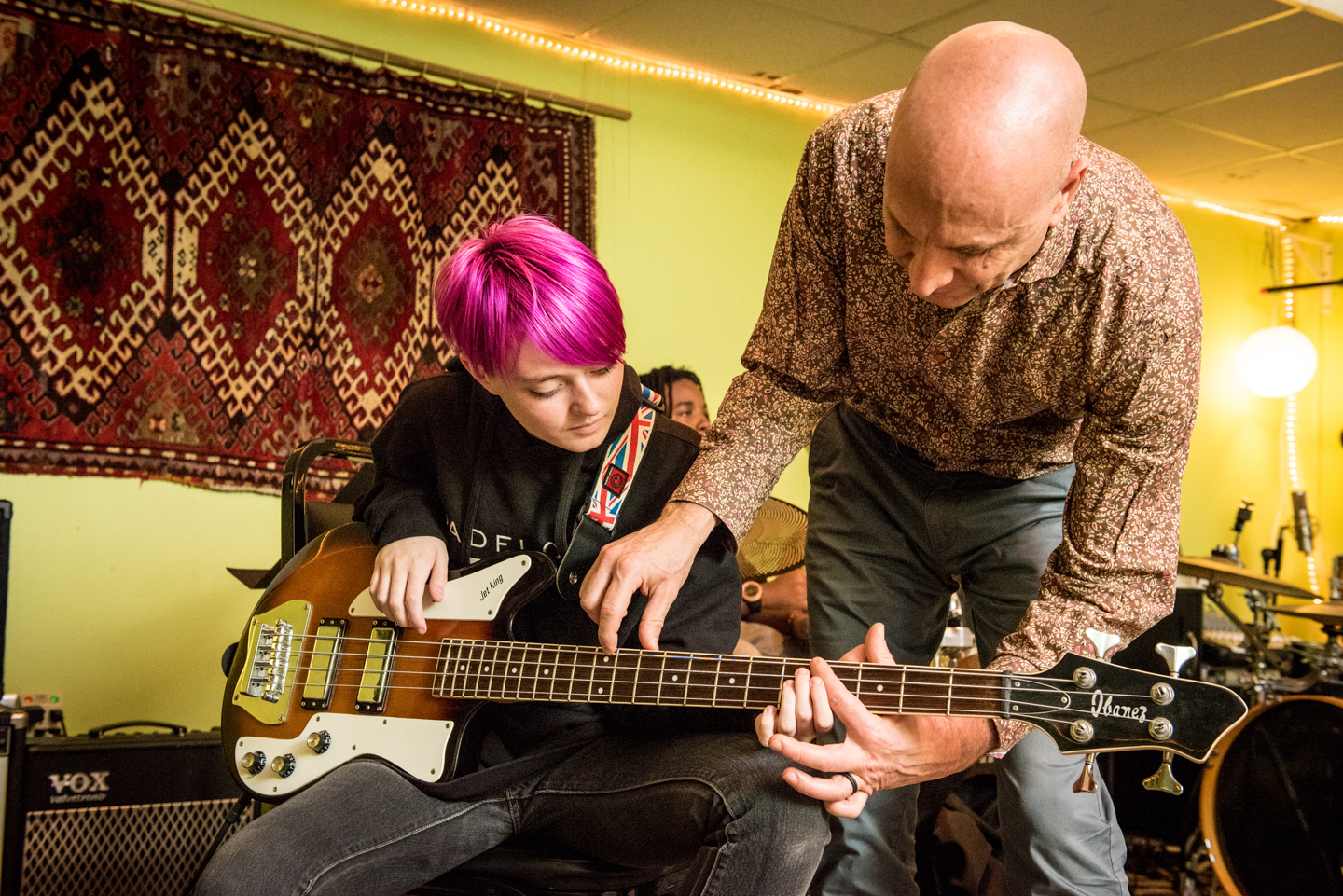 High School Student Playing Bass in a Holistic School