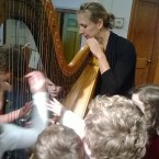 Private School Students Playing the Harp