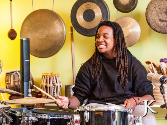 Man Playing Drums in a Holistic School