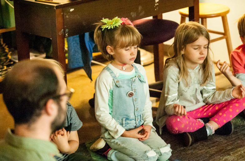 1-2 Students Meditating in a Holistic School