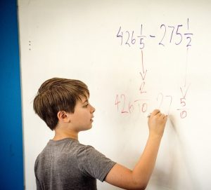 5th Grade Student Solves Math Equation